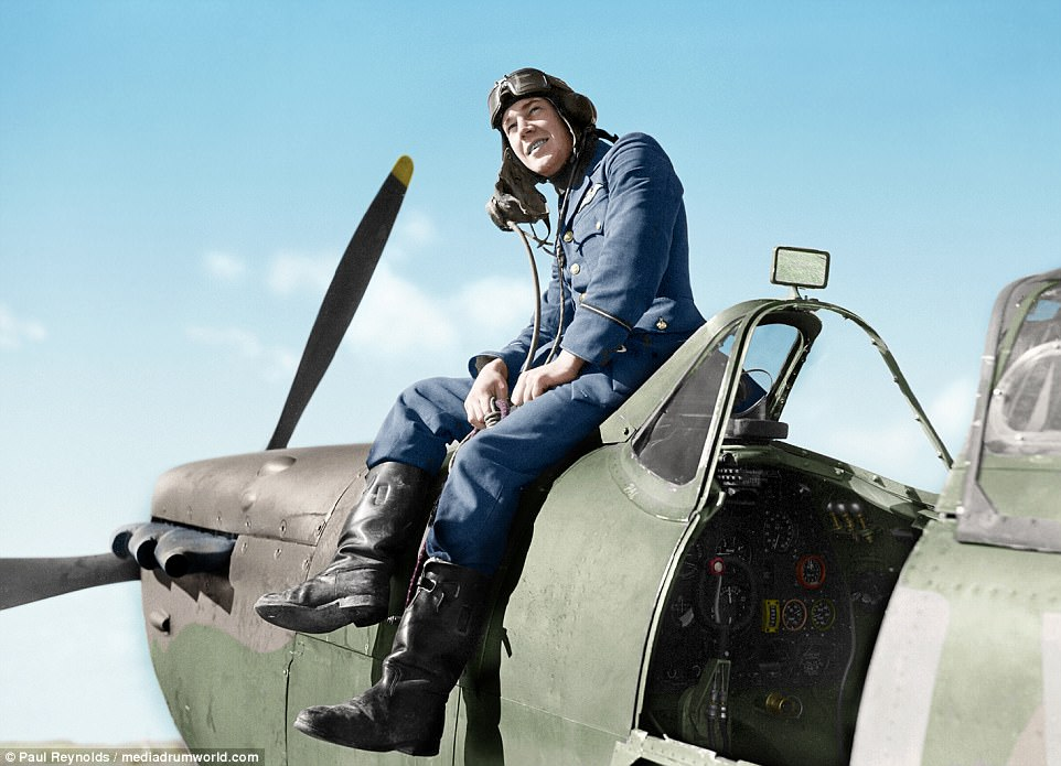 Spitfire pilot sitting on top of his aircraft